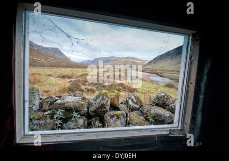 view from creagh dhu mountaineering club bothy shelter glencoe buachaille etive mor river coupal - Stock Photo