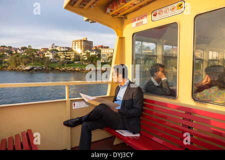 Sydney Australia NSW New South Wales Sydney Harbour harbor Parramatta River Mosmon Bay F2 ferry businessman Asian - Stock Photo