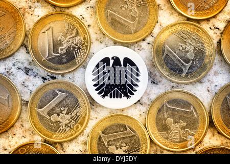 Geldmünzen und Bundesadler, Diätenerhöhung - Stock Photo