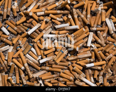 Cigarette butts as a background - Stock Photo