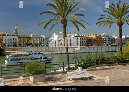 Sightseeing cruise on the river Guadalquivir and Triana district, Seville, Region of Andalusia, Spain, Europe - Stock Photo