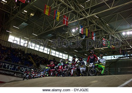 Manchester, UK. 19th April 2014.  Riders parading and warming up prior to the evenings finals of the BMX Supecross - Stock Photo