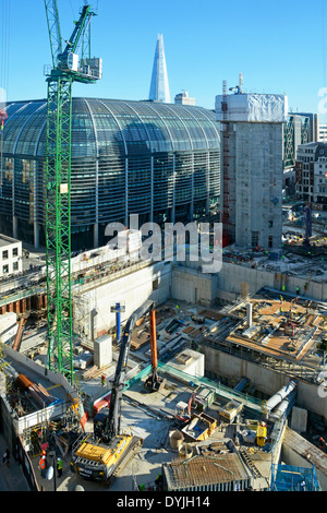Looking down on a major construction site at Bloomberg Place in the City of London with the completed Wallbrook - Stock Photo