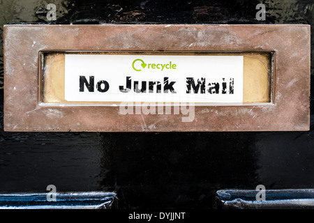 'No Junk Mail' sticker on letter box of door, London, UK - Stock Photo