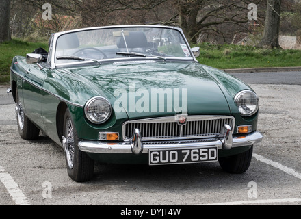 A classic British Racing Green 1966 MG-B roadster sports car in North Yorkshire England UK - Stock Photo