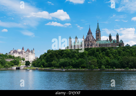 Canadian Parliament Hill viewed from across Ottawa river during a beautiful summer day - Stock Photo