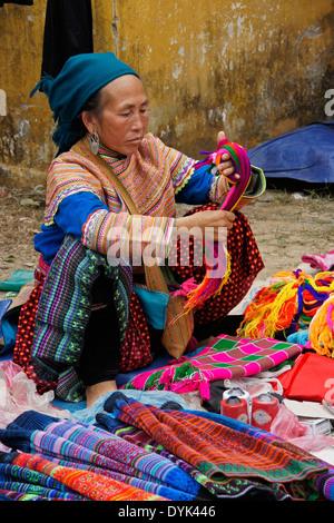 Flower Hmong woman selling in market, Nam Luc, Sapa (Sa Pa), North Vietnam - Stock Photo