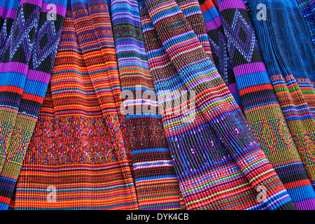 Flower Hmong pleated skirts for sale in market, Sapa (Sa Pa), North Vietnam - Stock Photo
