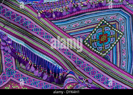 Flower Hmong embroidery for sale in market, Sapa (Sa Pa), North Vietnam - Stock Photo