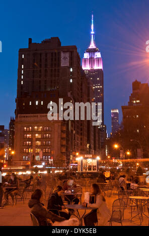 New York, USA. 19th April 2014: The Empire State Building is lit up in 'Pastel Fades' colors in celebration of Easter - Stock Photo