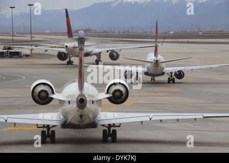 Jet airliners in line on tarmac airport Salt Lake City Utah - Stock Photo