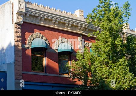 Interesting red brick building seen from the street  in Santa Barbara, California. - Stock Photo