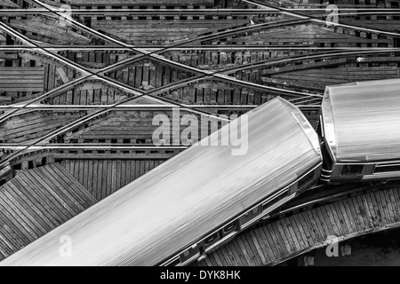 Elevated subway 'L' train moving on the tracks on a wooden platform in the Chicago Loop near Lake and Wells streets - Stock Photo