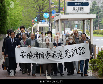 Tokyo, Japan. 21st Apr, 2014. Representatives of Tokyo citizens walk to a district court to initate legal proceedings - Stock Photo