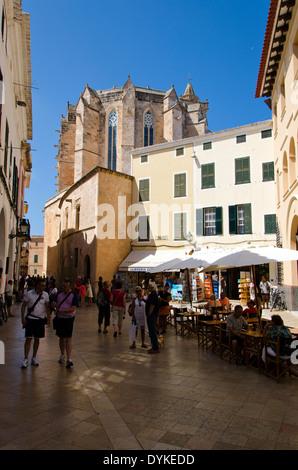 Street scene from Ciutadella Menorca. Cafes, bars & the Cathedral Basilica of Minorca. - Stock Photo