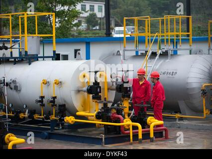 Chongqing, China. 21st Apr, 2014. Workers examine drilling facilities at the Fuling work zone in a branch company - Stock Photo