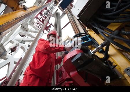 Chongqing, China. 21st Apr, 2014. A worker works at a shale gas drilling platform at the Fuling work zone in a branch - Stock Photo