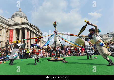 Trafalgar Square, London, UK. 21st April 2014. Maypole dancers entertain the crowd in Trafalgar Square on the annual - Stock Photo