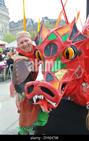 Trafalgar Square, London, UK. 21st April 2014. The Dragon and his handler in Trafalgar Square on the annual Feast - Stock Photo
