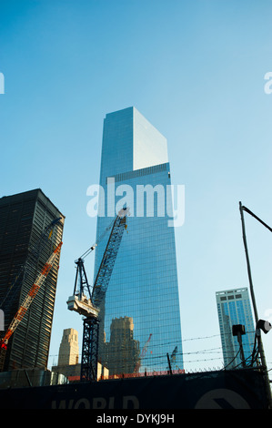 Tall glass buildings under construction in Lower Manhattan New York City - Stock Photo