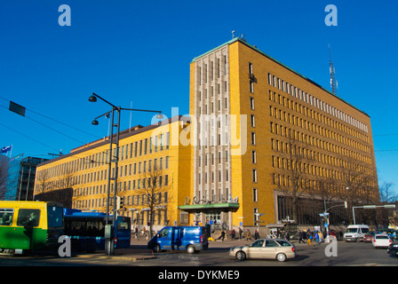 Traffic going past Postitalo (1938) the Functionalist style main post office building, Mannerheimintie street, central - Stock Photo