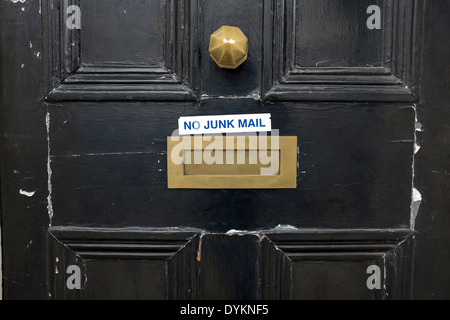 No Junk Mail Sign on Front door of London Property - Stock Photo