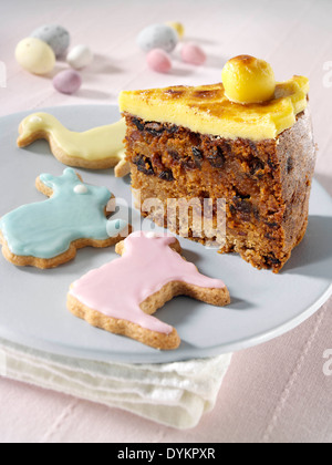 Simnel cake slice with animal biscuits - Stock Photo