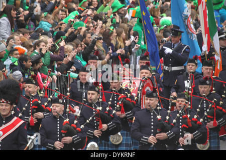 Members of the Dublin Fire Brigade pipe band during the Saint Patrick's Day parade in Dublin city centre - Stock Photo
