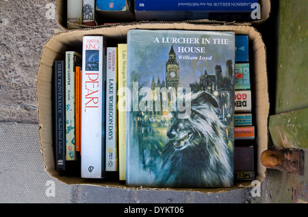 'A Lurcher in the House' by William Loyd in a box of books outside a secondhand bookshop in Edinburgh. - Stock Photo
