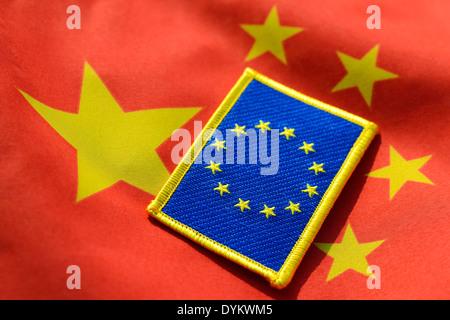 EU-Fahne auf China-Fahne, Wirtschaftsbeziehungen zwischen Europa und China - Stock Photo