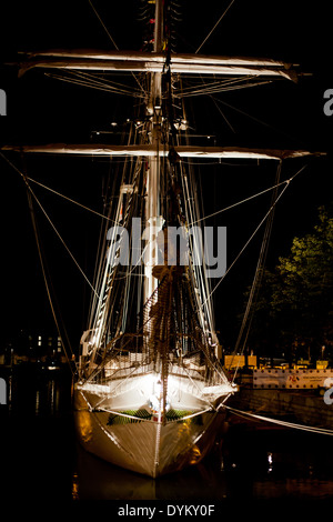 19th century sail ship from the Tall Ship's Race in Antwerp at night, beautifully lit. - Stock Photo