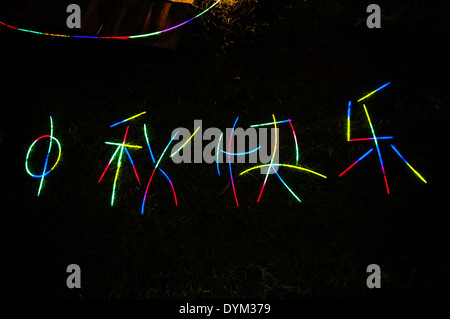 A greeting in glow sticks wishing a 'happy mid-autumn festival' in Victoria Park, Hong Kong - Stock Photo