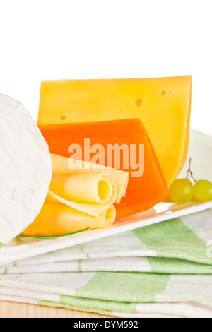 Luxurious cheese variation on white tray on kitchen cloth. Luxurious culinary eating. - Stock Photo