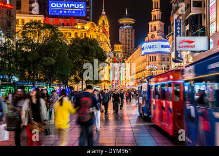 Nanjing Road, pedestrian zone and busy shopping street at night, Shanghai, China - Stock Photo