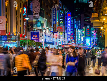 Nanjing Road, pedestrian zone and busy shopping street at night, Shanghai, China - Stock Photo