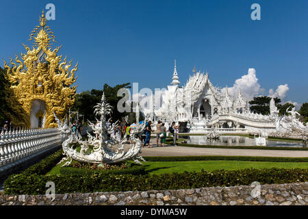 Ornate golend entrance of Wat Rong Khun, White Temple, by architect Chalermchai Kositpipat, Chiang Rai, Chiang Rai - Stock Photo