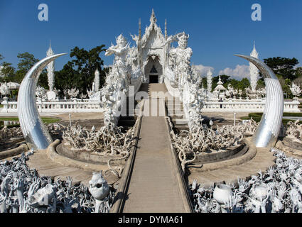 Depiction of hell, pleading hands on the stairs to the entrance of Wat Rong Khun, White Temple, by architect Chalermchai - Stock Photo