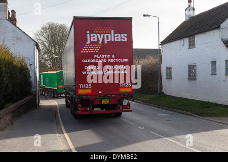 HGV (Heavy goods vehicle) traffic passing through the small village of Rempstone, Nottinghamshire, England, UK - Stock Photo