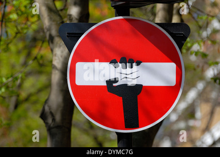 London, England, UK. Defaced traffic sign 'No Entry' near Charing Cross Road (2014) - by artist Clet Abraham - Stock Photo