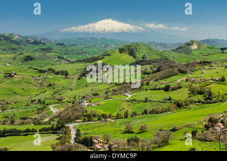 View to snow covered volcano Mount Etna from this central hill town in Spring; Gangi, Palermo Province, Sicily, - Stock Photo