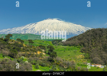 View to snow covered volcano Mount Etna in hill country near Nicosia in Spring; Nicosia, Enna Province, Sicily, - Stock Photo