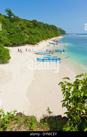 Outrigger boats on beautiful white sand beach in the national park on the south coast at Pangandaran, West Java, - Stock Photo