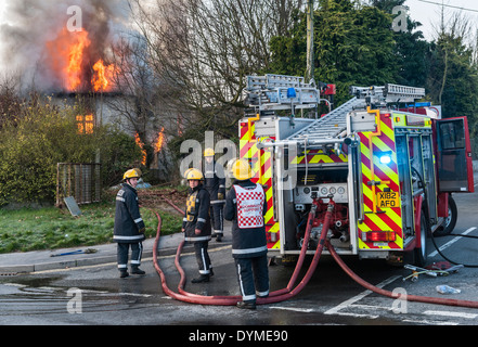 Firemen from the Welsh Fire Service attend a fire at a derelict house in Presteigne, Wales, UK. - Stock Photo