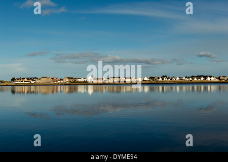 FINDHORN VILLAGE AND HOUSES REFLECTED IN THE BAY MORAY COAST SCOTLAND - Stock Photo