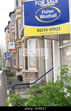 Street full of for sale and to let signs in Morecambe - Stock Photo