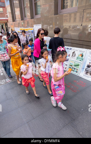 Sydney Australia NSW New South Wales Haymarket Chinatown Asian girl eating ice cream sweets woman family - Stock Photo