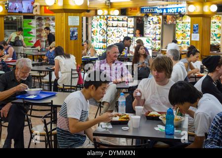 Sydney Australia NSW New South Wales Haymarket Dixon Street Dixon House Food Court Asian man friends eating dining - Stock Photo