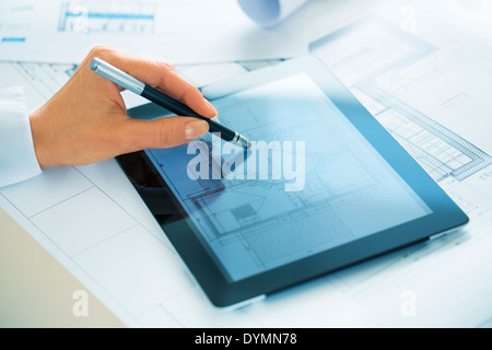 Close-up Of Hands Architect Woman Drawing with stylus on Digital Tablet - Stock Photo