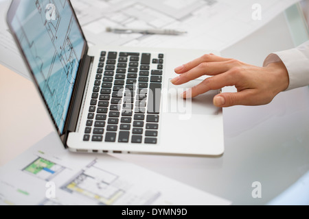 Close-up Of Hands Architect woman Using Laptop - Stock Photo