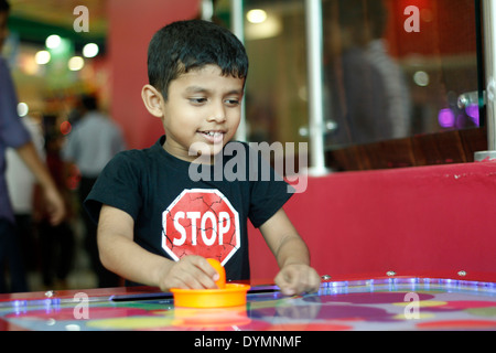 Indian Toddler Playing Air Hockey   Stock Photo